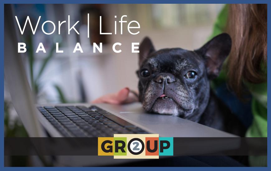 Work Life Balance - Woman holding dog & Laptop